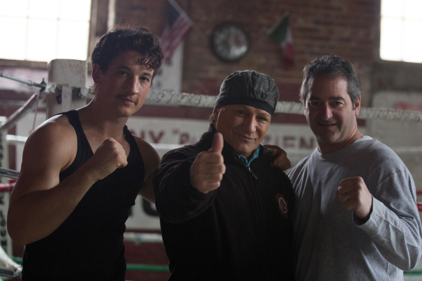 Teller and producer Chad Verdi join the real life Vinny Paz on the set.