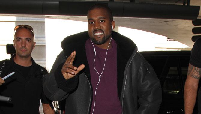 Kanye smiling at LAX