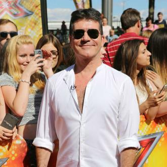 Matchmaker dad Simon Cowell
