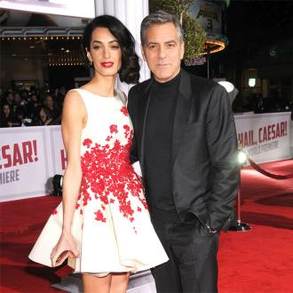George and Amal Clooney want to raise their kids out of the